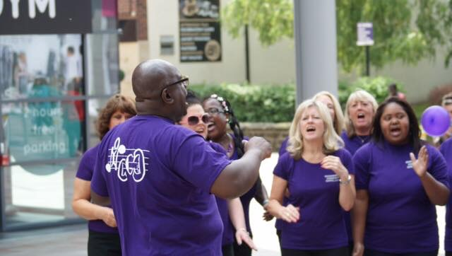 Edwin leading the choir at a fundraiser at Wakefield Trinity Shopping Centre